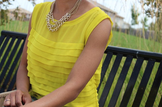canary yellow shirt, gold chain