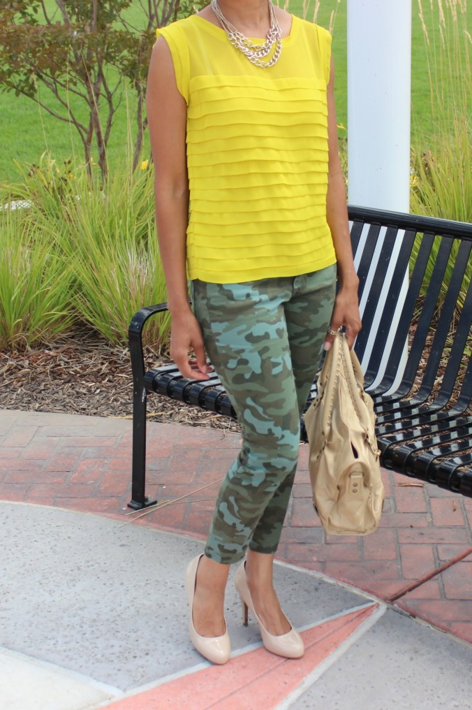 camo pants, canary yellow shirt, gold chain